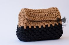 The lycra black and beige beauty-case