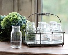 I found it! A half-pint mason jar compatible silverware caddy.