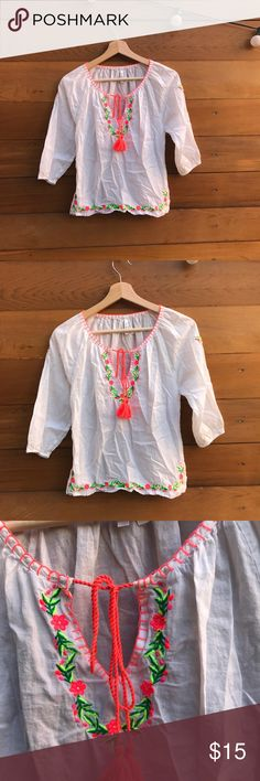 Embroidered blouse Beautiful combination of white shirt and neon embroidered flower design. Made in India . Size Small . 3/4 sleeve length Tops Blouses