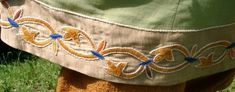 Acanthus leaf embroidery on the hem of a man's tunic.