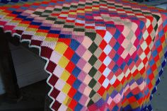 Had a blanket like this but the My blankets diamonds were in straight lines all the way to the bottom. My Nana made it and I still have it!