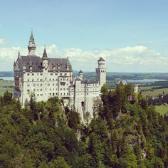 Germany's regal Neuschwanstein Castle reportedly served as the inspiration for the castle in Disney's Cinderella. Photo courtesy of garotasviajantes on Instagram.