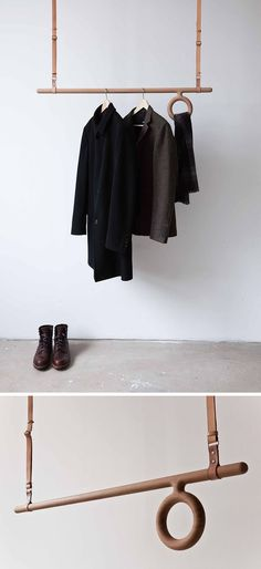 Interior Design Idea – Coat Racks That Hang From The Ceiling // This adjustable wood and leather coat rack has a wood rod acting as a place to hang coat hangers from and a circular wood offshoot that offers a home for your scarves or belts.