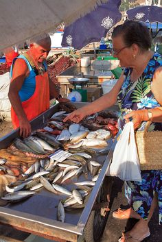 Woman buying fish in Trapani, Sicily