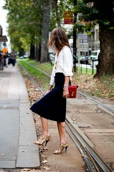 Navy skirt, white blouse and red purse.  www.luxeaporter.com