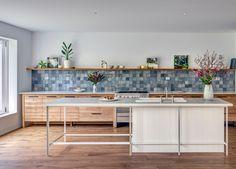 dreamy blue grey tile backsplash in a modern kitchen