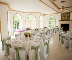 White chair covers with sage green sashes