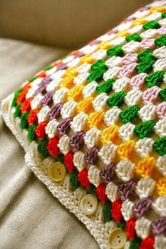 Good way to close a crochet cushion... buttons!