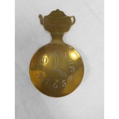 vintage Weba Ware brass tea caddy spoon with teapot shape handle and four o'clock face round bowl, UK