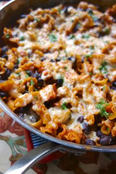 Spicy Chicken Enchilada Skillet - chicken, enchilada sauce, pasta and black beans - everything cooks in the same pot - ready in 20 minutes!