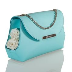 Grace Indaco #leather #pochette adorned with preserved #roses. More: linfaglam.com #bagslovers #bag #bags #handbags #handbag #borsette #borse #babyblue #lightblue #white #kawaii #cute #tender #purse #purses #flowers #rosebuds #trends #ss2016 #ss16 #madeinitaly #fashion #moda #springcollection #bluesky #style #elegant | #LinfaGlam #Leather and #Rattan #Handbags with stabilized #Flowers | #Green #Woman #Fashion #Bags #Nature #Handmade #Purse #Purses | Made in Italy