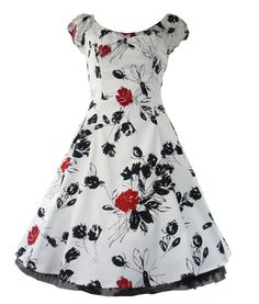 """Beautiful,+heavy+cotton,+50's+dress+with+puff+elasticated+cap+sleeves.++Fully+lined+with+white+cotton+underskirt+edged+with+black+netting.++Bow+to+front.++Hidden+elasticated+strip+to+back+for+perfect+fit.++Invisible+zip+to+side.++Pleats+at+side/waist+to+give+a+50's+flare+to+dress.  +  +Can+be+worn+with+or+without+a+Hell+Bunny+25""""+length+petticoat+"""