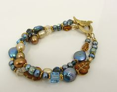 pearls and Swarovski, blue and brown
