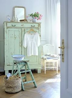 sweet room...... love the shabby cupboard & step ladder. nice whites & basket xo