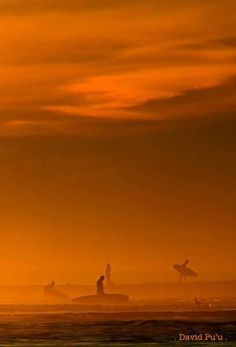 Sunset at C-Street Ventura by David Pu'u. This really captures the feeling of coming in after a primo sunset session. The water glowing, the people on the beach watching the sunset, the big orange sky...