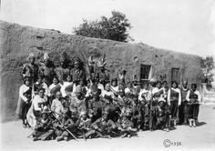 """From """"El Paso's Missions and Indians"""" by Cleofas Calleros 1951. (Photo by Casasola.) """"Tigua Indians in full regalia as they gathered at Cacique's home prior to their trip to Dallas, Texas, June 1936. Cacique was the chief at the time. The older lady in the second row, seated, second from left is my Great-Grandmother Felicitas Provencio Romero."""