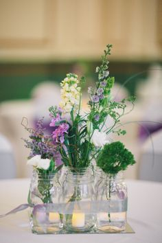 Wildflower Centerpieces- So simple and pretty, while also being generally less expensive