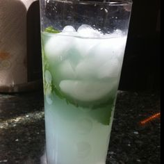 Skinny Mojito using Crystal Light Mojito mix, club soda, light rum and lots of mint leaves (muddled, of course!).  YUM!!!
