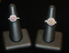 On the left is a beautiful ring with a pink diamond center stone ring with a halo of diamonds, and on the left is a pretty yellow diamond ring with a pink diamond halo in rose gold, as well as a second halo of white diamonds - both available at Becker's!
