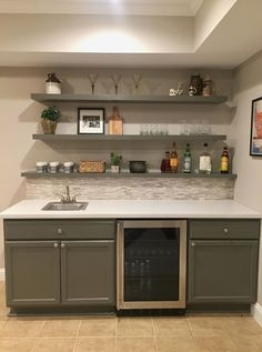 Basement bar almost done. Backsplash tile and cabinets from HD. Shelves from Ikea, paint SW Porpoise. #Basements Basement Bar Designs, Basement Ideas, Wet Bar Basement, Basement Family Rooms, Basement Makeover, Basement Inspiration, Basement House, Basement Renovations, Basement Bathroom