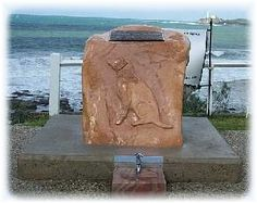 AUSTRALIAN WAR DOG MEMORIAL - The monument recognizes the enormous contribution by the war dogs that saved countless soldiers lives in Vietnam. The monument was unveiled at a ceremony on Saturday 7th April 2001 at 12 noon at The Bluff, Alexandra Headland, Sunshine Coast, Queensland, Australia. At the base of the rock at the foot of the carving is a drinking trough where local dog owners can water their animals while walking their dogs.