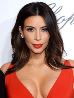 Kim Kardashian middle-part loose waves with flirty eyelashes and red lipstick   allure.com