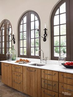 Fabulous arched windows inset into slightly recessed openings along the sink wall.
