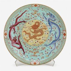 A Chinese large turquoise-ground famille rose dish, daoguang mark and possibly of the period, enameled to interior with two dragons chasing fiery pearls amidst clouds, DAOGUANG six-character reign mark in blue to base. D: 15 in.