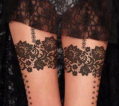 Lace tattoo tights. I like the design.
