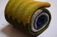 ...beautifully knit Chevron Baby Blanket by Purl Soho, as knit by amiijjang