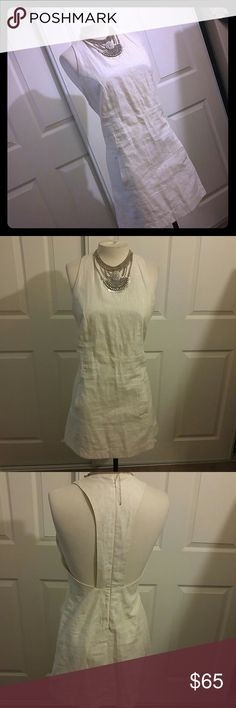 Classy Top Shop. White and silver Minidress Very cute dress EUC. Has pretty T back with hidden zipper. Size 10 but runs smaller so more like an 6 or 8. Has small silver stripes. Great dress for any occasion. Topshop Dresses Mini