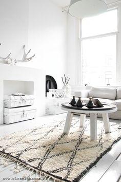 white living room black and white rug