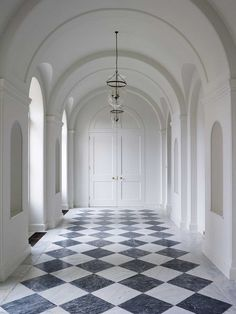 What is your favorite part of this shot We cant decide between the checkered ceramic floor, the white wainscoting on the walls, or the arched ceiling and doors! Home Interior, Interior And Exterior, Interior Design, Floor Design, House Design, Checkerboard Floor, Home Luxury, Checkered Floors, Black And White Marble