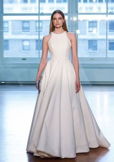 Jackie by #JustinAlexander An exposed zipper runs up the illusion back, turning a classic #weddingdress into a modern masterpiece. Pictured is the crepe version, and it also is available in silk dupion. More of a classic bride? Ask for this style with buttons instead of the zipper. COLOR SHOWN IN Ivory