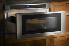 The newest microwave ovens are under-counter models that free up counter space and make it possible to have a real vent hood over the stove.