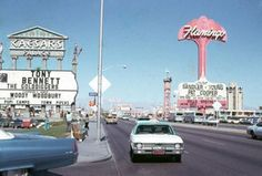Las Vegas, 1970 old photo of the Strip with  Caesar's Palace and Flamingo Hotel & Casino's vintage signage.