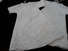 Two Angel gowns with beaded lace overlays.