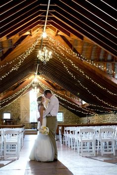 chandeliers and string lights in a rustic setting