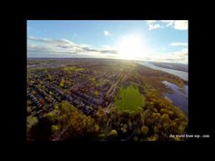 I flew here over the Ottawa river, with beautiful waters, sky and near sunset view. Amazingly stable video.