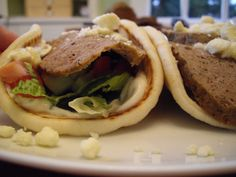MADE- Crockpot gyros. Perfect with homemade tzatziki sauce, lettuce, tomatoes, red onions, and crumbled feta.