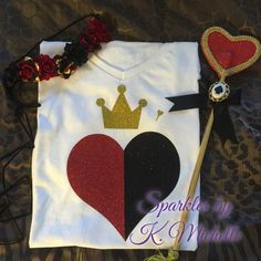 Inspired Queen of Hearts Shirt. Heart is made with glitter black and glitter red colors. Turn heads with this one of a kind design perfect for Halloween or Disney theme. PLEASE NOTE FLOWER CROWN AND WAND ARE NOT PART OF LISTING. *~COPYRIGHT NOTICE~* Please note that as the customer you are only paying for my creative services and supplies. I do not claim ownership for any characters being used and all images are free and are not being sold. THIS IS NOT A LICENSED PRODUCT. All images belon...