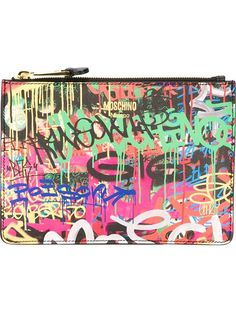 Shop Moschino graffiti print clutch in CHUCKiES New York from the world's best independent boutiques at farfetch.com. Shop 300 boutiques at one address.