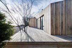 AR Design Studio replaces landslide-damaged holiday home with larch blocks