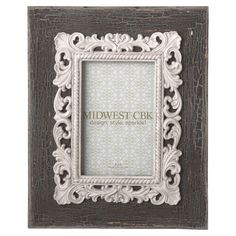 Weathered wood picture frame with a scrolling laurel leaf border.   Product: Picture frameConstruction Material: