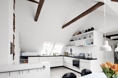 kitchen with sloped ceilings and beams
