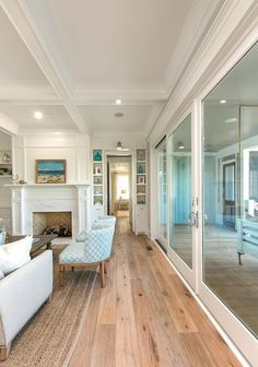New Beach House with Coastal Interiors features DuChateau Danube from The Riverstone Collection. - Via Home Bunch