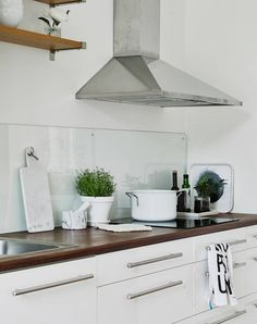Neutrals and clean lines in old an building - via cocolapinedesign.com | Like clear transparent splashback which would enable the lime plaster to be seen in the kitchen behind the cooker and adjacent work surfaces.