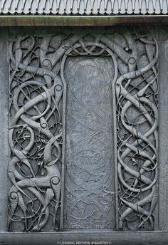 Urnes stave church, woodcarving, intertwined vegetal and animal forms on the outside walls.