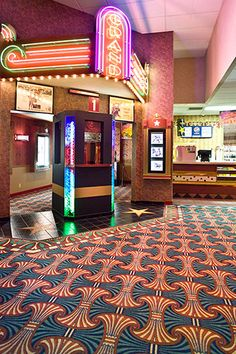 Custom floor covering at Grand Theatres helps provide a regal, classic moviegoer experience for guests. #customcarpet #floorcovering #interiordesign