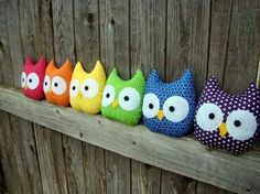 Owls on a fence.  Old section of fence with colorful owls perched...possible wall art.